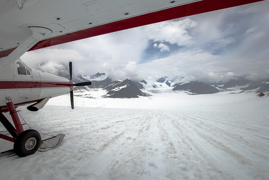 front of the plane on a wintery runway in Alaska